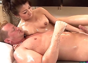 Lovely asian masseuse gets doggystyled