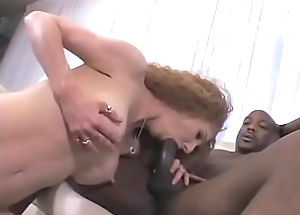 Gradual red confined MILF Annie Convention receives will not hear of muff pounded by black stud