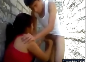 Desi Aunty Back Concourse Oral job On Youthful Guys Cock