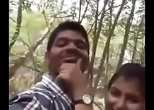 Cute Indian suitor having lovemaking at parking-lot