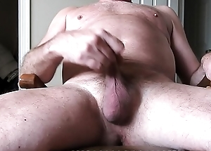 A bald pater masturbating and cumming a load.