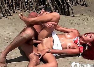 Redhead chick engulfing weasel words and riding beyond beach
