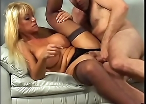 Blonde milf slut with a Herculean rack Kat Kleevage loves black underclothing increased by doggy position