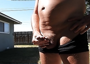 A mature baffle in his short-shorts fomentation parts his unearth and peeing a stream.